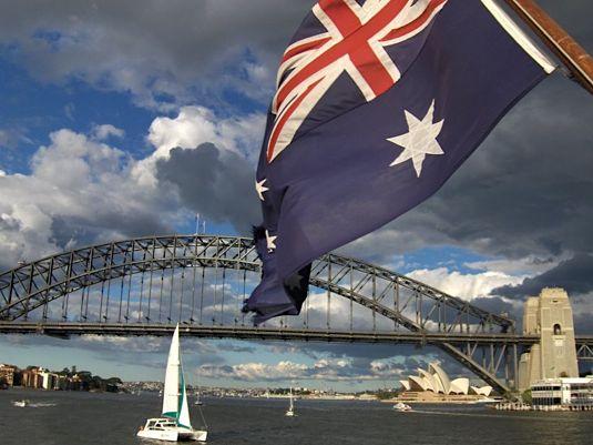 Australian flag and Sydney Harbour Bridge. Photo by Lindsay.