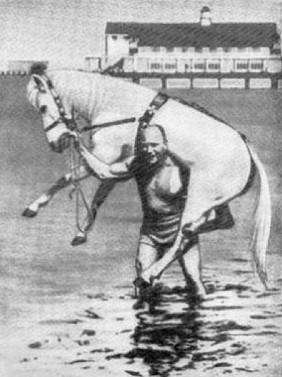 Alexander Zass (The Amazing Samson) carrying horse